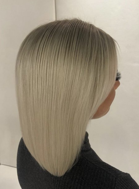 Girl with icy white hair being bleached and toned to a cool colour at the klinik hairdressing London