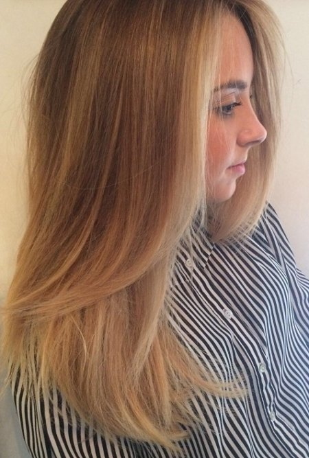 A balayage has been refreshed by adding baby highlight around the hairline by Thea at the klinik salon Islington London
