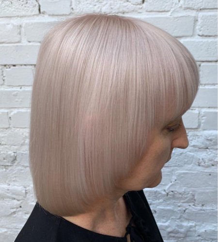 beige cream hair colour on lady with a short page cut done by Anna at the klinik London