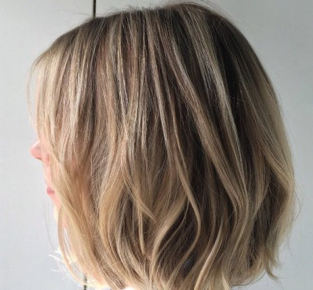 Tussled bob created by texturising the hair throughot with cool highlights throughout at the klinik salon London