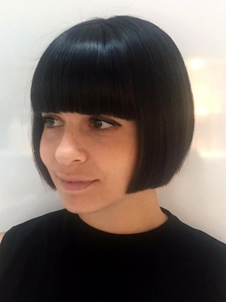Hair has been cut into a short bob with a full fringe by leyla at the klinik hairdressing in London Farringdon