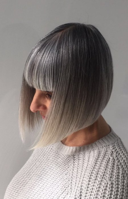 Silver grey hair has been cut into a stunning classic bob with a square fringe by Mark at the klinik hairdressing in Exmouth Market London EC1R4QE