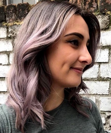 Silver grey hair has been toned with a bit of lilac by Kenra metallics and Pravana to add a bit of change to the tone by Thea at the klinik hairdressing London