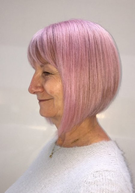 Natural white hair has been given a pink finish with Schwarzkopf BlondeMe Instant blush, Strawberry, by Leyla at the klinik, hairdressing