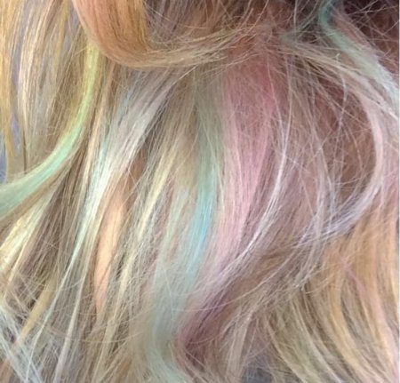 On a blonde base, Leyla has added rainbow colours  to create an interest