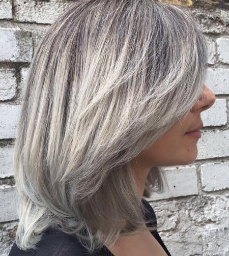 Hair has been coloured using a balayage technique and then colouring the tips silver using Affinage toner. Done by Thea at the klinik hairdressing LOndon