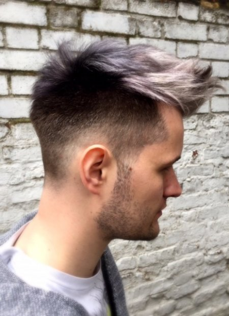 Short gents haircut being coloured in a black / grey / siver fade to achieve an amazing blend and depth to his hair. using Olaplex throughout the service. Done by Thea at the klinik hairsalon London.