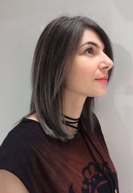 Hair being coloured using a balayage technique going from a dark base to silver using Olaplex and Igora Royal colours done by Thea at the klinik hairdressing London Exmouth market EC1R 4QE