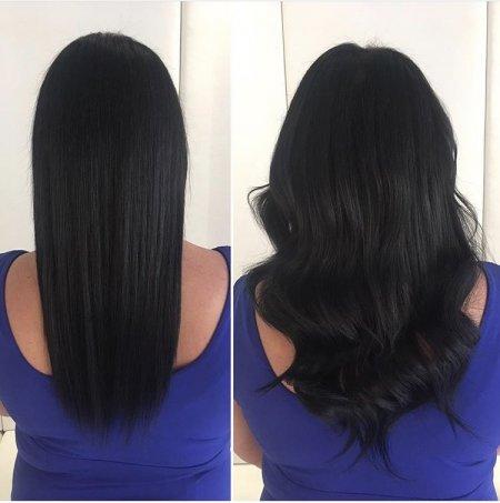 Dark brown almost black shoulder long hair being extended long by Leyla at the klinik hairdressing using the Easilocks System.