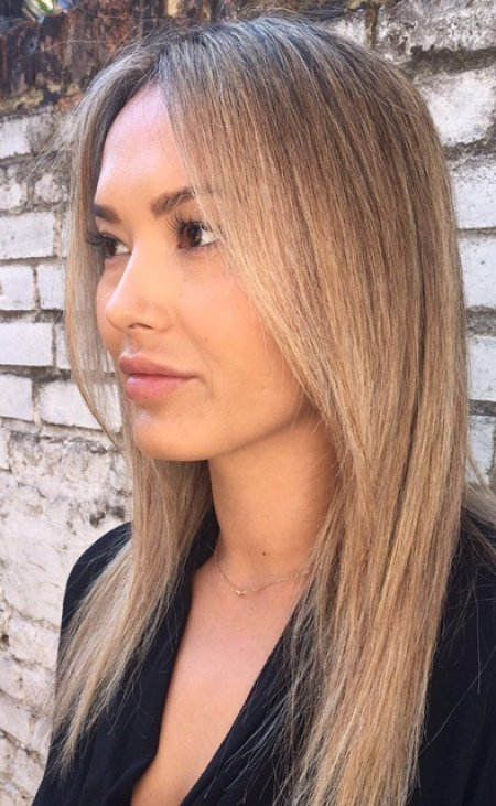 Long straight hair has been coloured using babylights to create a soft blonde that looks sunkissed and natural. Hair done by thea at the klinik hairdressing Farringdon