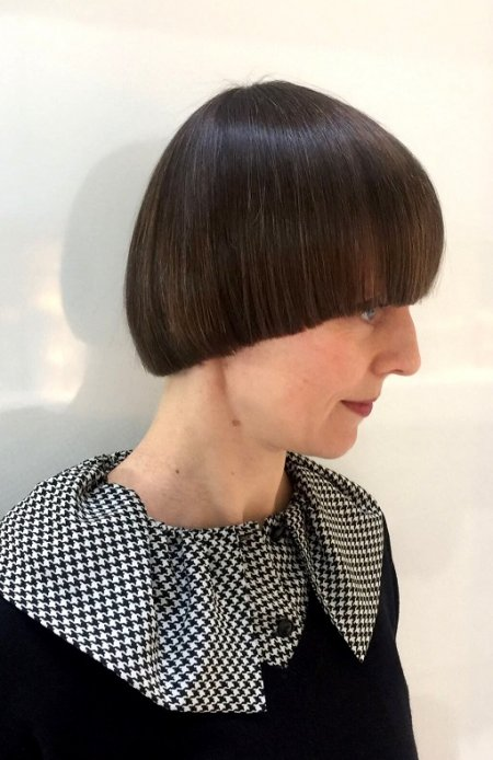 Hair being cut into a pageboy style by Mark at the klinik hairdressing in London. This shape is also known as a bowl cut.