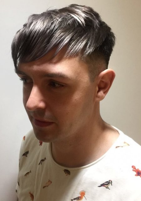Gents hair coloured into a charcoal grey with white tips to create texture throughout the layers. Done by Mark at the klinik hairdressing London.