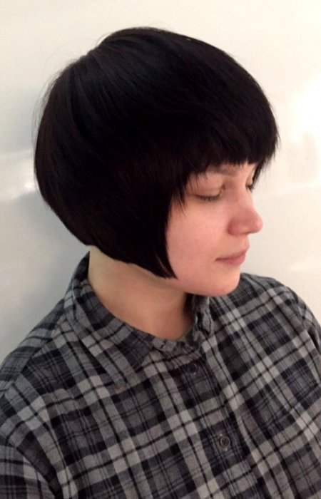 Tomboyish cut giving it an elegant dishevelled bob with a textured fringe by Mark at the klinik hairdressing Islington London
