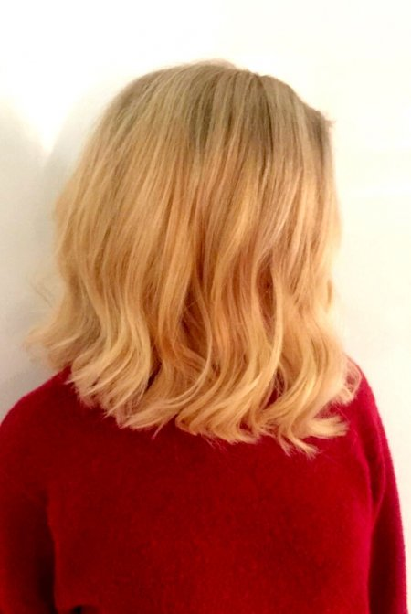 Marks client originally had highlighted hair but she wanted to opt for a more all over colour blonde. Mark applied pre lightener all over and then toned it to a soft natural blone.