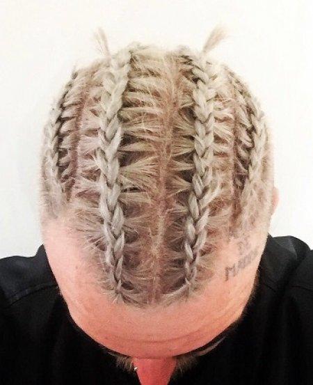 Graduate stylist Nik has created cornrow on a short hair at the klinik hairdressing London
