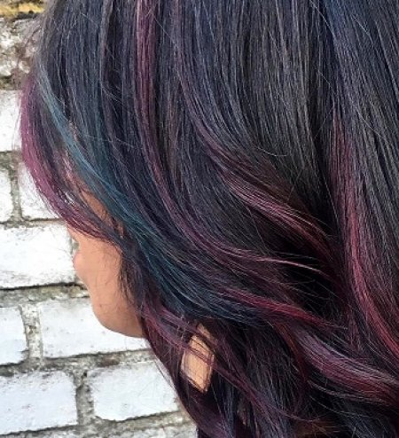 Hair coloured in magnenta and emerald to give texture to the hair at the klinik hairdressing London