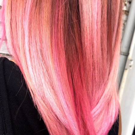 Hair pre lightened and then coloured pink with Fudge Pink Moon by Thea at the klinik salon Lodon