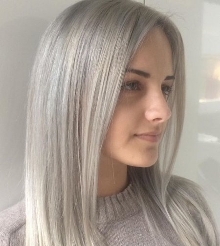 Platinum blonde hair being coloured to achieve a root shadow to give a softer regrowth in the future, by Thea at the klinik salon London