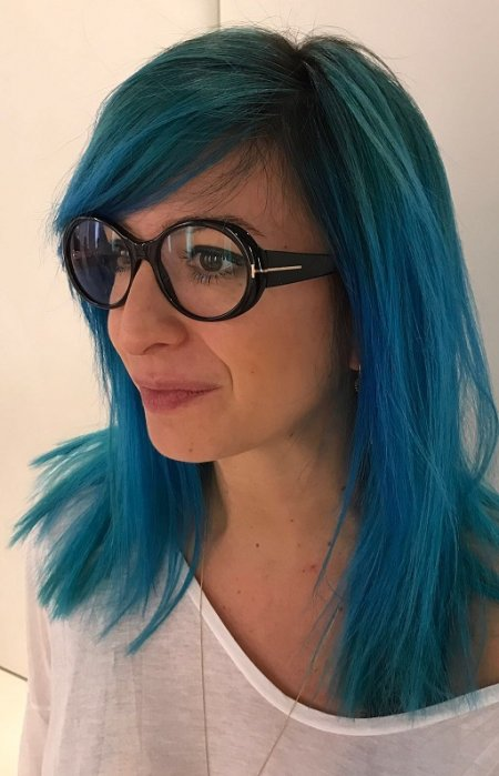 Hair  being coloured Blue by using Manic panic woodoo colour by Thea at the klinik salon London Islington