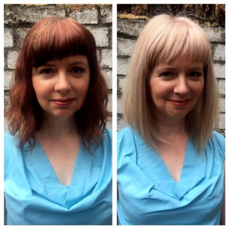 Coloured red hair has been transformed into a cool blonde in one visit at the klinik hairdressing Using Blondme 9 lift by Thea.