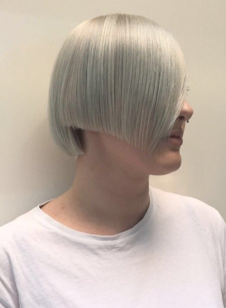 A sharp cut has been done leaving the fringe area long. Hair has been pre lightened and toned to an icy finished tone. Done by Mark at the klinik London