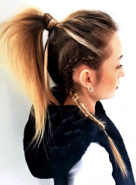Long hair tied up in a loose messy ponytail with a twisted small plait on one side behind ear done by Corina at the klinik hairdressing London
