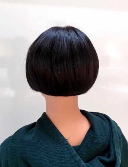 Short black haired bob cut by our graduate stylist Yasmin at the klinik hairdressing.