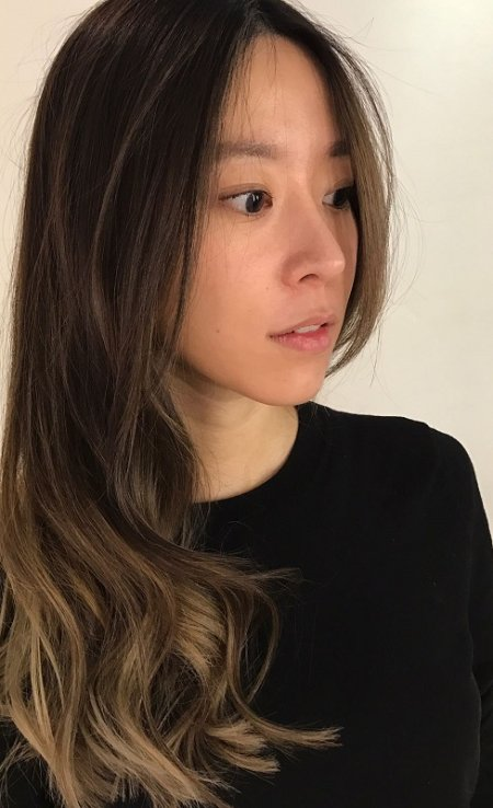 Dark asian hair being coloured with a baby highlight /balayage technique to create a soft ashy blonde by Thea at the klinik hairdressing