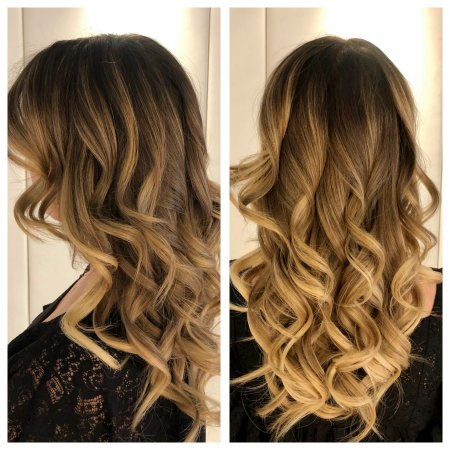 Long blonde hair in a balayage technique with dark roots and blonde ends done by Leyla at the klinik hairdressing London