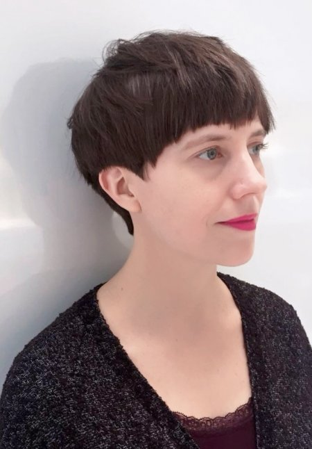 Short haircut softly textured with a graduation and a short fringe cut by Mark at the klinik hairdressing in London EC1