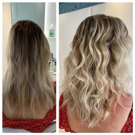 Long blonde hair highlighted and tonged into a beachy finish at the klinik salon London