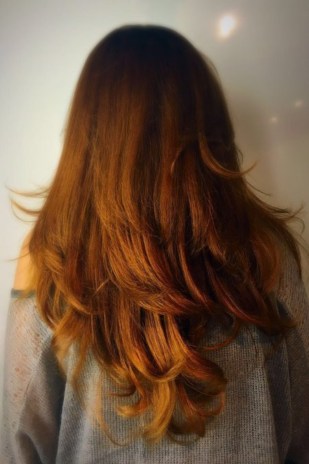 Dark copper toned hair enhanced with pure copper on the ends by Thea at the klinik hairdressing