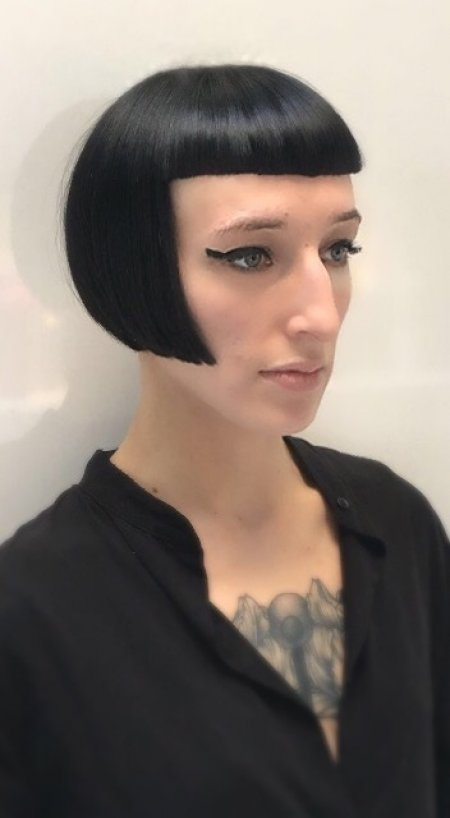 New stylist Mark at the klinik cuts a strong bob with a short fringe.