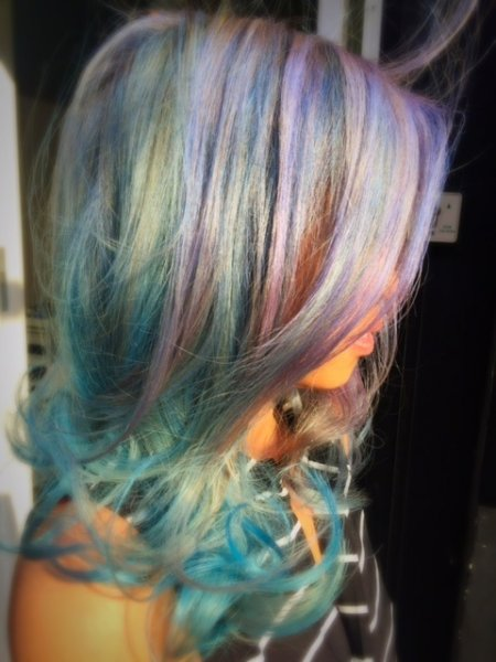 Mermaid hair being coloured in multi colour from pink, blue, silver by Thea at the klinik hairdressing London