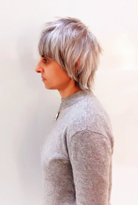 A long length cut been cut into a modern take Mullet. It compliments the clients natural white hair that has a natural depth underneath. All done by Mark at the klinik hairdressing in London