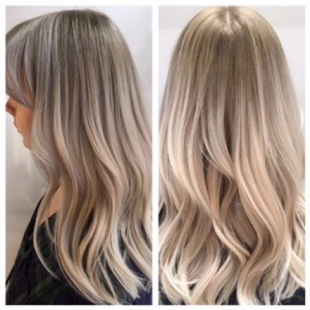 Silver hair has been recoloured into a more natural beige white hair. It is a really creamy blonde with a bit of a root drag to add depth. Olaplex was used throughout and GHD ironds to create the perfect wave.