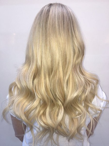 Summer beachy hair tousled into a beachy finish with GHD irons