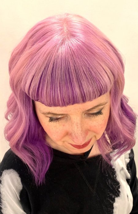 Hair coloured pink with a short retro fringedone by Anna at the klinik hairdressing London