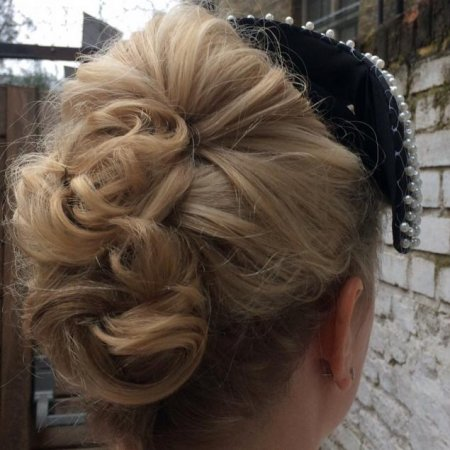 Blonde hair updo, personally entwined and pinned with loose curls