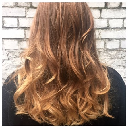 Hair has been coloured in natural tones to give a very subtle balayage
