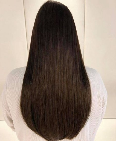 A girl with long brown hair showing off Easilocks extensions at the klinik salon London