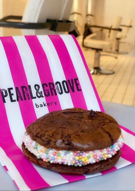 A squidgy cake on a pink and white bag from our new naighbours Pearl and Groove in Exmouth Market