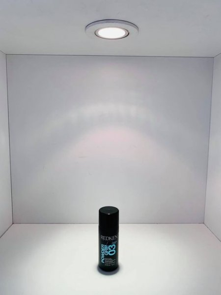 A black small bottle called Powder Grip by Redken is standing in a white box with a spotlight on top showing off product of the weekat the klinik salon London