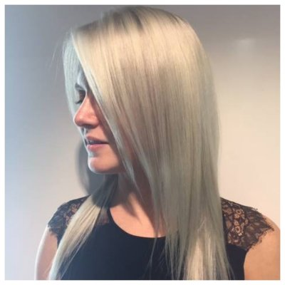 Prelightened hair with a snow white icy toner created by Thea at the klinik
