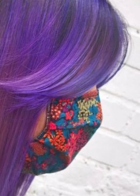 girl with purple hair matching her flower face mask at the klinik hairsalon London