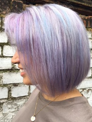 Hair coloured a multi toned purple by Leyla at the klinik Islington London