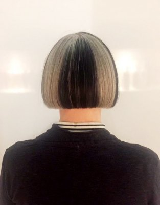 Natural grey hair has been coloured black on certain areas on hair to create a block effect at the klinik hairdressing London.