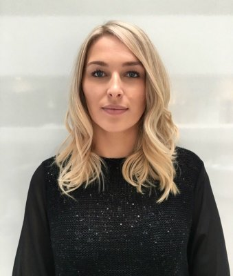 Long natural dark blonde hair has been coloured into a creamy blonde finish and tonged using the GHD irons to give a beachy finish by Leyla at the klinik hairdressing London EC1R 4QE