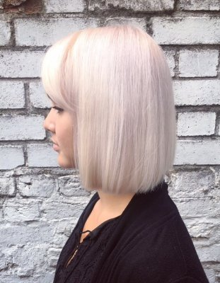 Hair has been coloured from a dark base to a really light platinum base by Leyla at the klinik hairdressing Islington
