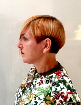 Hair has been cut shorter on one side to give an assymetric finish for the bob done by Mark at thye klinik hairdressing London